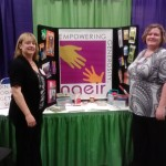 From left - Patti A. Woolsey and Dawn R. Parton with NAEIR Exhibit Display