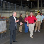 From left to right - NAEIR President & CEO and Treasurer Dan Rutherford touring NAEIR's warehouse